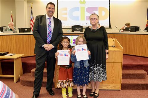 3.	Zavala Elementary students Ylenajyn Willowsky Chino and Shayla Edwards pose with Dr. Muri and Trustees Carol Gregg.