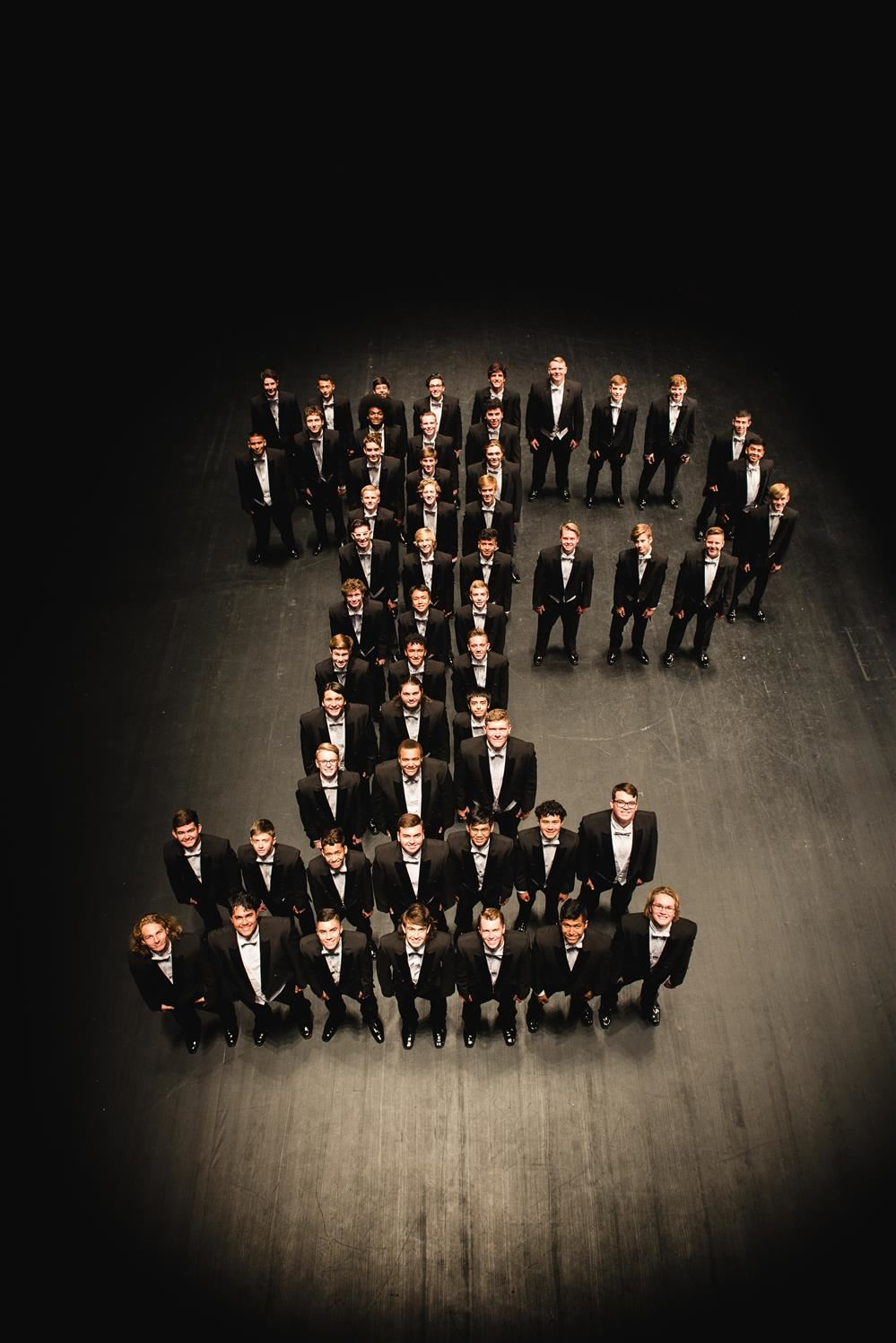 Members of PHS Cantus, photographed from above; they are arranged in the shape of the letter 'P'